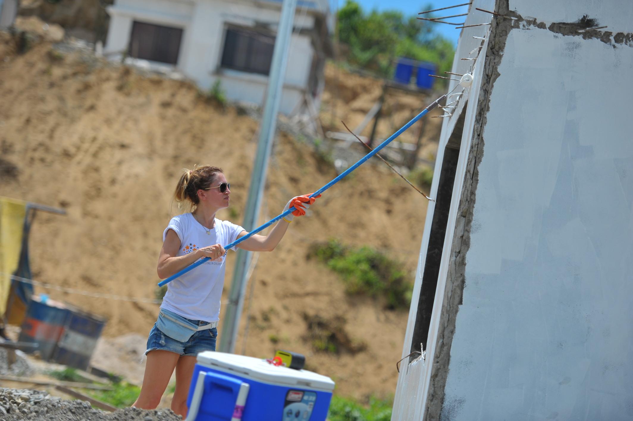 Faye – Employee volunteers painting