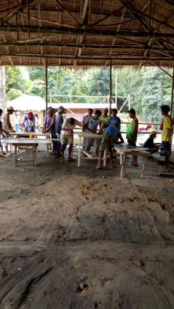 Men making tables