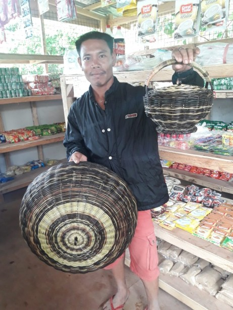 "Cherwin Pamplona weaves ""Nito"" baskets and food covers."
