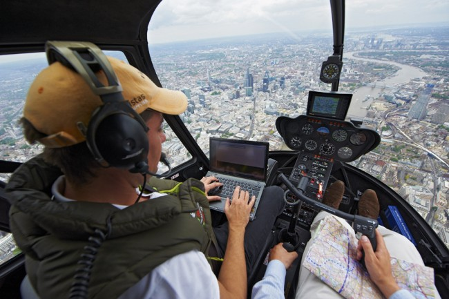 Internationally renowned ForEx trader and CEO of Knowledge to Action, Greg Secker, will make money from thin air on Friday as he hovers above the City as the Flying Trader.  A trained helicopter pilot, Greg will be flying his chopper 10,000ft above London while trading live on the foreign exchange markets. Anyone can join in as Greg sends his trades down to the City beneath him, with all brokerage commissions going to child-based charities Barnardo's and The Ubuntu Education Fund, on June 24, 2011 in London, United Kingdom.  For more information about using this image contact Micha Theiner: T: +44 (0) 7525 627 491 E: micha@michatheiner.com http:///www.michatheiner.com